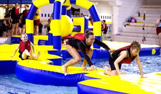 Aqua Challenge – Indoor Pool Inflatable Obstacle Course at Water Meadows Nottinghamshire.